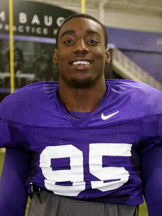 File - In this Dec. 13, 2012 file photo, TCU defensive end Devonte Fields poses for a photo at the team's training facility following a practice for the Buffalo Wild Wings Bowl in Fort Worth, Texas. Fort Worth police are investigating whether Fields pointed a gun at his former girlfriend and punched her in the head. Police said Tuesday, July 22, 2014, that no charges have been filed and Fields, the Big 12's preseason defensive player of the year, has not been arrested. (AP Photo/Tony Gutierrez, File)