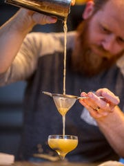 Lead bartender Jack Keane makes a new cocktail at Sundry