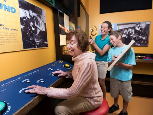 Visitors enjoying one of the many interactive exhibits