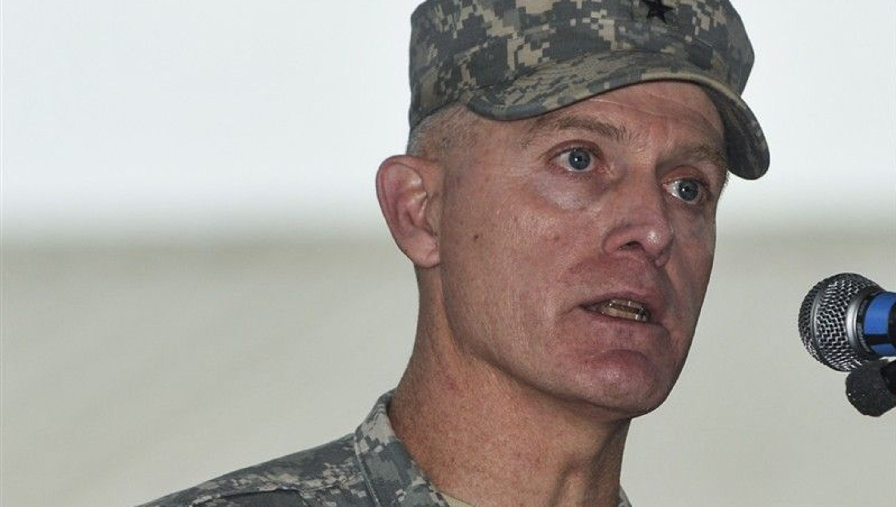 Disgraced Army general fired after 'inappropriate' relationship  with young woman on staff
