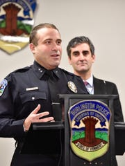 Burlington Police Chief Brandon del Pozo, left, and Mayor Miro Weinberger appear at a news conference in December 2015.