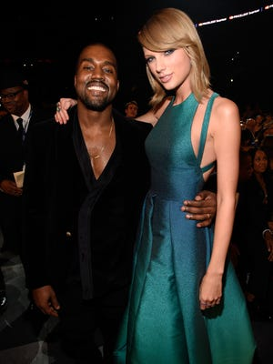 Kanye West and Taylor Swift attend the 57th annual Grammy Awards on Feb. 8, 2015, in Los Angeles.