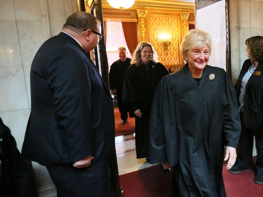 Wisconsin Supreme Court Justices (from front to back) Chief Justice Patience Roggensack, Rebecca Bradley and Daniel Kelly enter the Assembly chambers.
