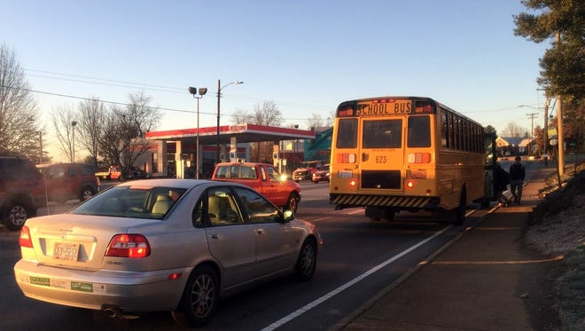 Students board a bus Friday morning at a Patton Avenue stop near Johnston Boulevard that police say is the site of repeat violations.