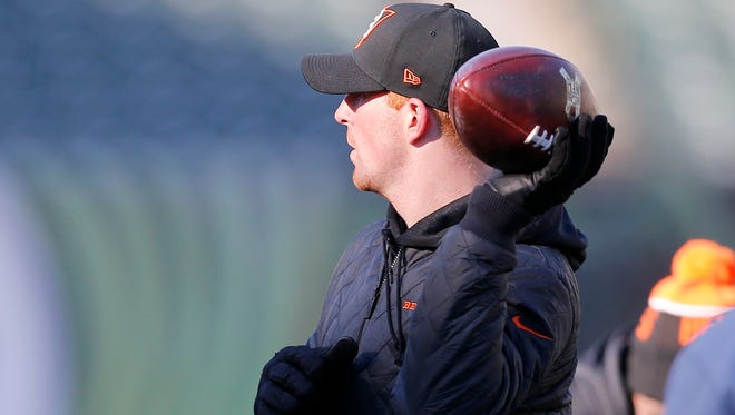 Andy Dalton attempted a pass in practice on Tuesday -- left handed.
