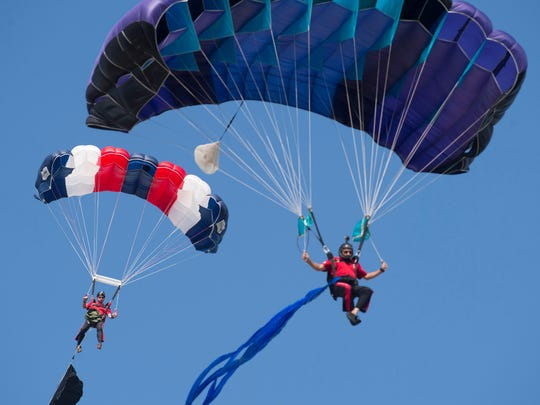 Muster crowds look forward to the demonstrations by the Navy Parachute Team known as the Leap Frogs.