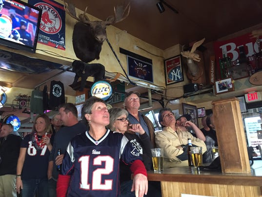 Patriots fans intently focused on watching a game