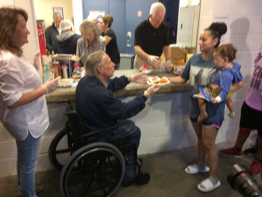 Texas First lady Cecilia Abbott serves dinner with her husband to evacuees of Hurricane Harvey at an Austin shelter. (Photo: John C. Moritz/USA TODAY ...