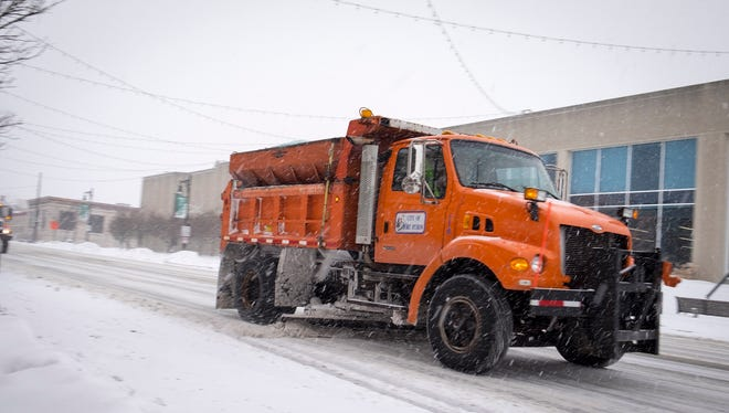 City snowplows clear the streets in downtown Port Huron on Feb. 9.