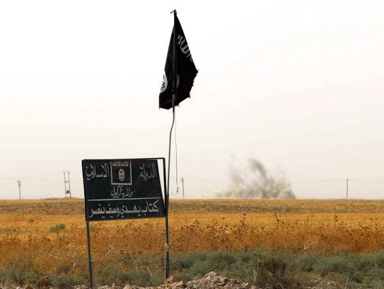 An Islamic State flag is seen south of the northern