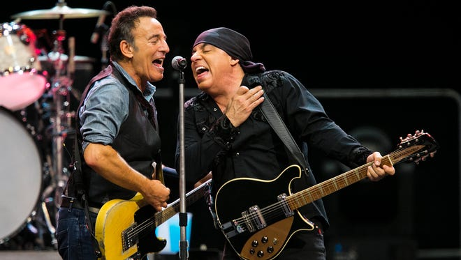Bruce Springsteen  belts one out with Stevie Van Zandt and the E Street Band, at Jobing.com Arena on their 2012 WRECKING BALL TOUR.  It was the first tour without their sax player, Clarence Clemons.  The show was more than three hours long.  Springsteen had the large crowd on their feet most of the night.  A special tribute was given to local resident, soul singer Sam Moore, as well as Clemons.    @TomTIngle2