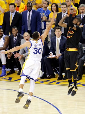 Kyrie Irving shoots the game-winning shot over Stephen Curry in Game 7 of the NBA Finals.