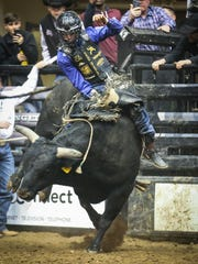 Sage Kimzey rides a bull called Told You So during