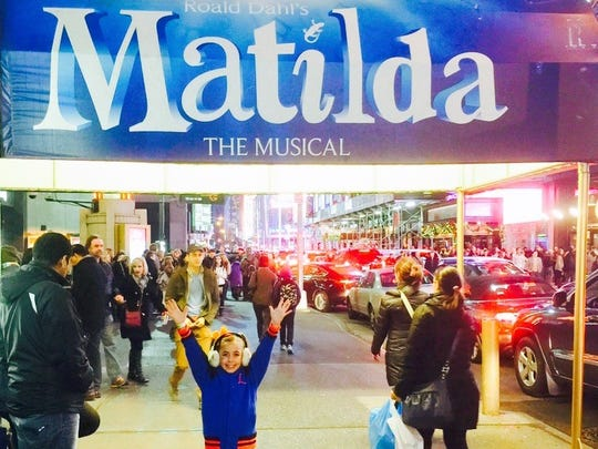 """GiaNina Paolantonio poses outside the theater where """"Matilda"""" is performed."""