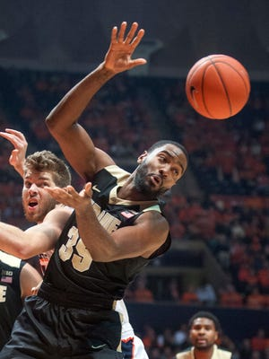 The ball gets away from Purdue guard Rapheal Davis (35) and Illinois forward Michael Finke (43) in Champaign, Ill., on Jan. 10, 2016.