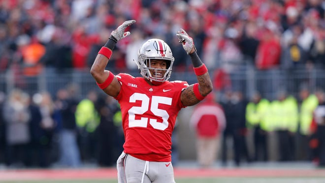 Ohio State defensive back Brendon White celebrates after making a tackle against Michigan during the second half of an NCAA college football game Saturday, Nov. 24, 2018, in Columbus, Ohio. Ohio State beat Michigan 62-39. (AP Photo/Jay LaPrete)