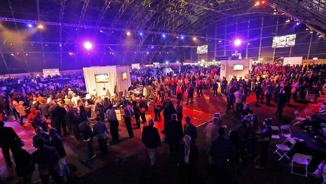 Guests sample foods at the Taste of the NFL Party with a Purpose at WestWorld in Scottsdale January 31, 2015.