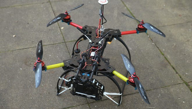 A quadcopter drone equipped with a camera stands on pavement prior to take off on November 17, 2014 in Berlin, Germany.