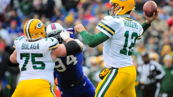 File photo of Aaron Rodgers in action against the Bills last season, with tackle Bryan Bulaga attempting to block Mario Williams.