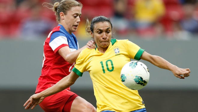 Brazil's Marta Vieira, right, fights for the ball with United States' Christie Rampone, during a match of the International Women's Football Tournament at the National Stadium in Brasilia, Brazil, Sunday, Dec. 14.