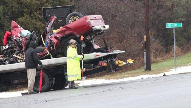 A three-vehicle crash killed three people in Phelps on Tuesday morning.
