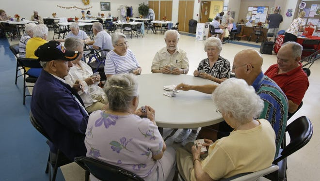A group of retired senior citizens gather for cards at the Citrus County Resource Center in Lecanto, Fla. In Citrus County, more than a third of residents are senior citizens.