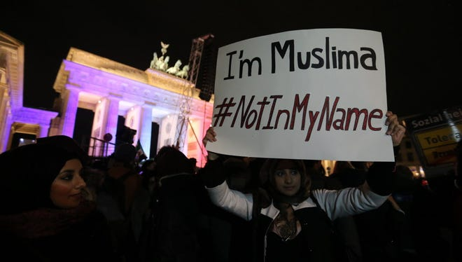 Muslims rally against terrorism Tuesday at the Brandenburg Gate in Berlin, nearly a week after the Charlie Hebdo attack.