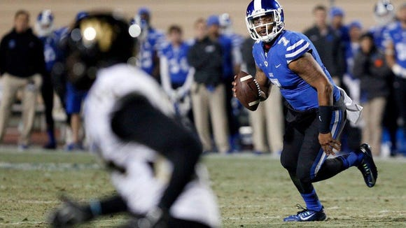 Duke quarterback Anthony Boone (7) looks for a receiver against Wake Forest on Nov. 29 in Durham, N.C.
