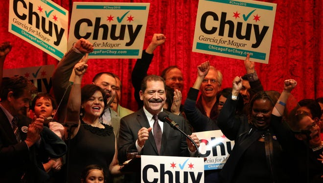 "Chicago mayoral candidate Jesus ""Chuy"" Garcia addresses supporters with his wife, Evelyn, at his side at his municipal election night gathering at the Alhambra Palace Restaurant in Chicago on Feb 24, 2015."