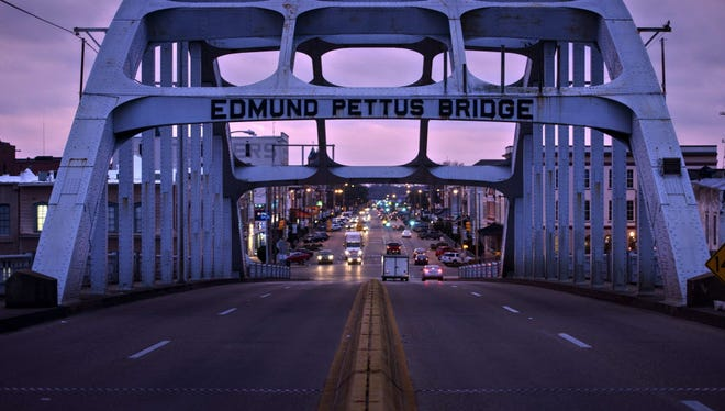 The Edmund Pettus Bridge, where Route 80 crosses the Alabama River, is viewed at dusk on March 5, 2015, in Selma, Ala. March 6 marks the 50th anniversary of Bloody Sunday, when civil rights marchers attempting to walk to the Alabama Capitol in Montgomery for voters' rights clashed with police on the Edmund Pettus Bridge.