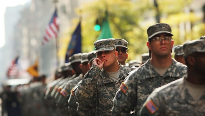 Soldiers with the U.S. Army march in the annual Veteran's Day Parade along Fifth Avenue on November 11, 2014 in New York City.