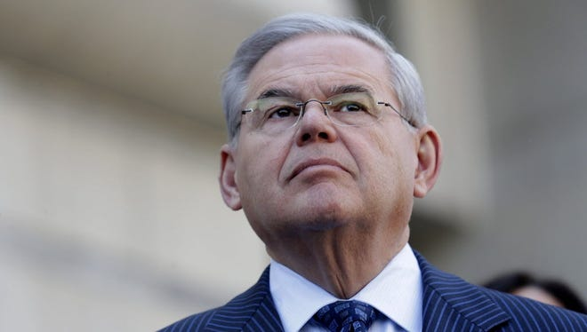 Sen. Robert Menendez, D-N.J., speaks with reporters after his arraignment on federal corruption charges at federal court in Newark, N.J., on April 2, 2015.