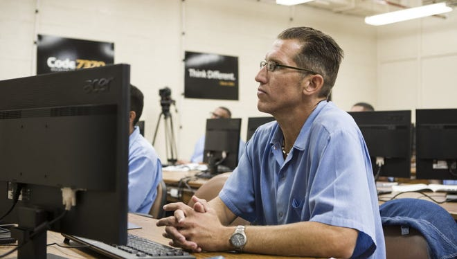 San Quentin inmate Chris Schuhmacher takes a coding class at the prison  on  Nov.  13, 2014. On Monday he graduated from Code.7370.
