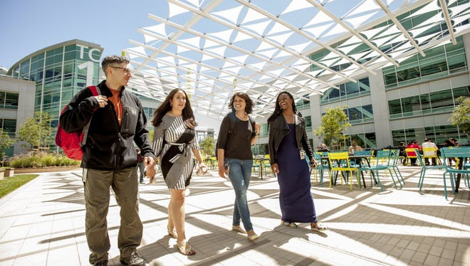 Google employees Jason Buberel (far left), Ashley Carrick, Aruna Kommu and Jessica Moore walk through Google's Tech Corners campus in Sunnyvale, Calif. Buberel volunteers his time to help train fellow employees on unconscious bias.