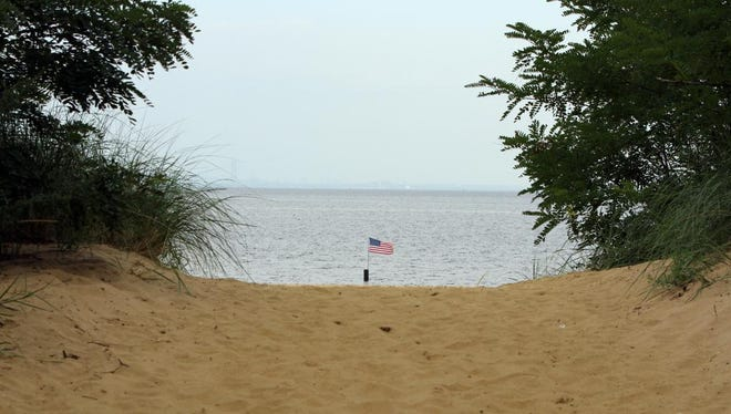 A flag flies in the water at the Ocean Avenue entrance to Ideal Beach in the Port Monmouth section of Middletown.