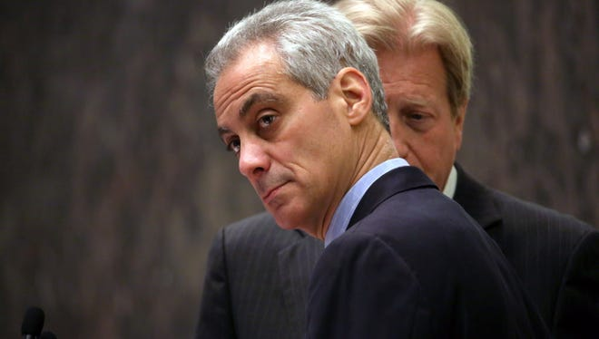 Chicago Mayor Rahm Emanuel, left, with corporation counsel Steve Patton by his side, presides over the Chicago City Council for the first time after being re-elected mayor on April 15, 2015.