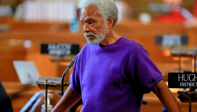 Sen. Ernie Chambers of Omaha listens in Lincoln, Neb., Wednesday, May 27, 2015, to debate on overriding Gov. Pete Ricketts' veto of a death penalty repeal bill, in a vote that would make it the first traditionally conservative state to abolish capital punishment in more than four decades.