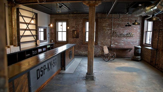The tasting room displays the original distillery spirits plant number or DSP, given to Henry Kraver (pictured in the back) in 1889 when he founded Peerless Distillery in Henderson, Kentucky, June 2, 2015.