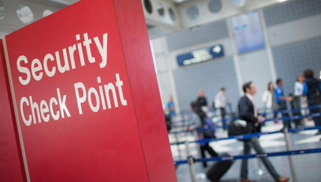 A sign directs travelers to a security checkpoint staffed by Transportation Security Administration workers at O'Hare Airport on June 2, 2015 in Chicago.