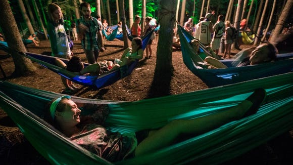 Stephanie Petit of Brick, N.J. relaxes in the the Hammock Hangout at the Firefly Music Festival in Dover last year.
