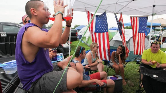 Robin Chan of Richmond, Va. drinks up at his campsite at Firefly last year.