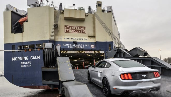 2015 Ford Mustang is loaded on a ship vessel at the Port of Portland in Portland, Ore.. The car is being exported globally.