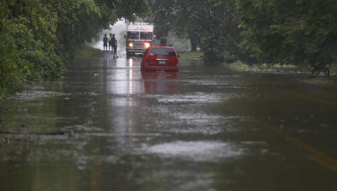 Logan-Rogersville FD rescues woman and child from SUV stuck in water.