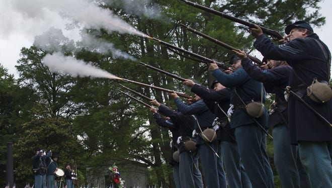 Members of the Sixth Ohio Volunteer Infantry reenactors group fire a 21-gun salute during a Memorial Day ceremony to honor soldiers who died in the Civil War, Monday, May 25, 2015, at Spring Grove Cemetery in Cincinnati. The cemetery is the final resting place of thousands of Civil War soldiers, both Union and Confederate.