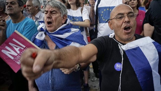 Supporters of a Yes vote on this coming Sunday's referendum - meaning accepting new European loans and their austerity measures - gathered in Athens Tuesday just before Greece defaulted on a $1.8 billion loan repayment.