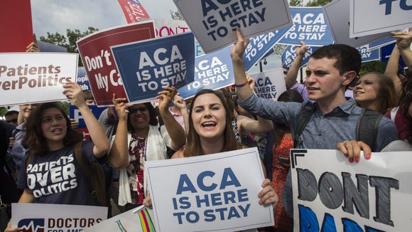 Supporters of the Affordable Care Act cheer after the