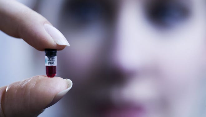 Theranos' patented Nanotainer, shown here full of blood and being held by company founder Elizabeth Holmes, just got approval from the FDA along with other Theranos technology.