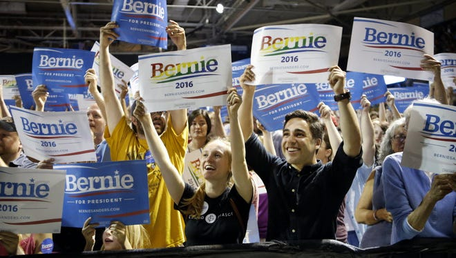 Supporters of Democratic presidential candidate Bernie Sanders cheer at a campaign rally in Portland, Maine, on July 6, 2015.