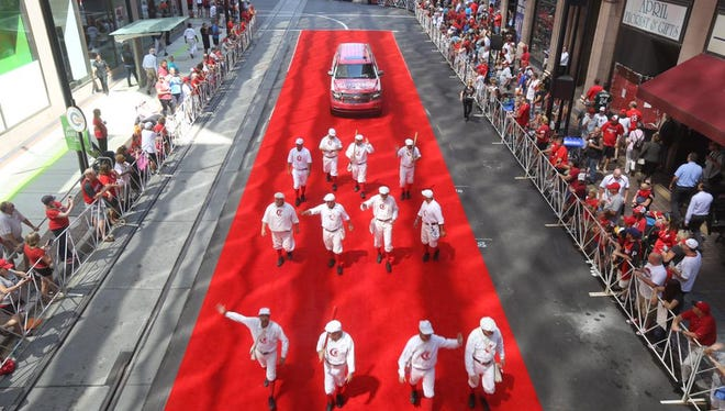The Cincinnati Red Stockings help kick off the parade on Tuesday.
