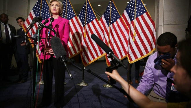 Democratic U.S. presidential hopeful Hillary Clinton speaks to members of the media July 14, 2015, on Capitol Hill in Washington, DC.